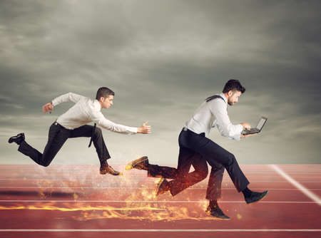 Businessman with four legs runs with too many tasks on laptop. Concept of competition and success