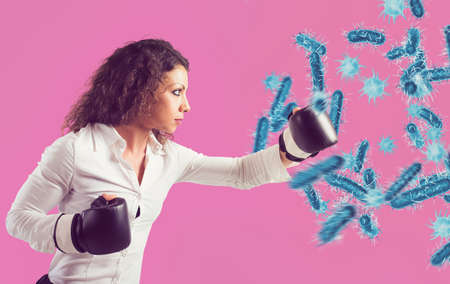 Fight with fists against bacteria and diseases Stock Photo