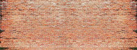 Grunge background of a wall of bricks. Interior, rough. Stockfoto