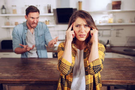 Husband and wife fight and she is tired of listening. Difficult relationship and separation concept