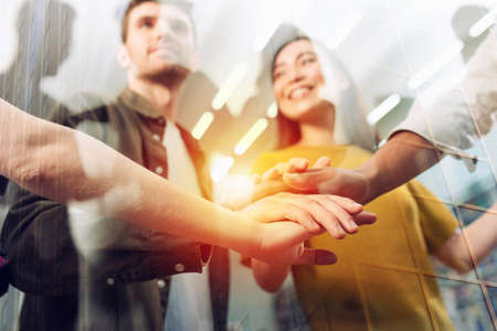 Business person put their hands together. Concept of teamwork, agreement and partnership. Double exposure