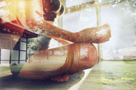 Young girl relaxing in yoga position in front of a bright window. Double exposure Stock Photo