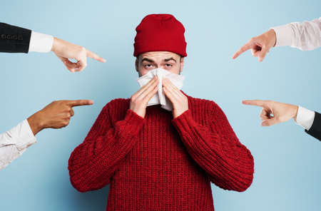Boy caught a cold is accused of infecting the virus. Studio on Cyan background Stock Photo