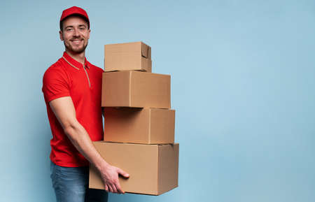 Courier has a lot of boxes to delivery. Emotional expression. Cyan background