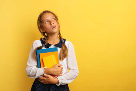 Young student watch something with wondered expression. Stockfoto