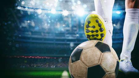 Close up of a soccer striker ready to kicks the ball at the stadium Фото со стока - 143330174