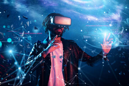 Boy with VR glasses play with a virtual videogame 免版税图像 - 143331680