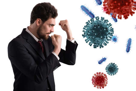 Businessman fights like a boxer. Concept of viruses and bacteria attack 版權商用圖片