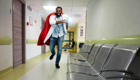 Medic acts like a superhero in hospital to fight pandemic of covid19 coronaviruses. Blue background