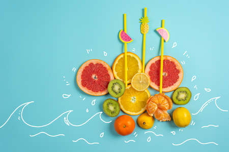 Composition of orange and lemon on yellow background