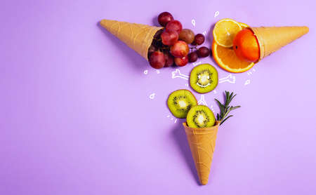 Ice cream with natural fruits. Concept of genuine and biologic fruit. Purple background