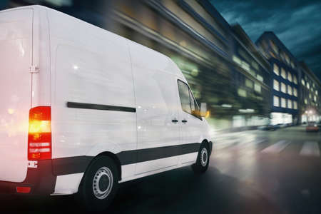 Super fast delivery of package service with a fast moving van on cityscape