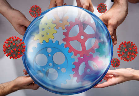 Business team connect pieces of gears protected by a glass sphere from coronavirus covid-19. Concept of startup, integration and partnership