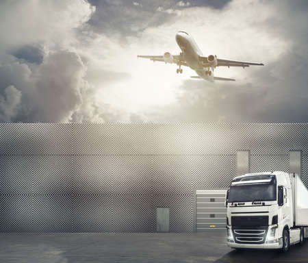 White truck in the forecourt of an interchange port ready to load the goods and reach the destination. International shipping logistics concept Standard-Bild