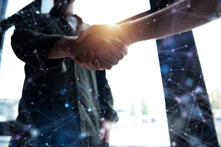 Handshaking business person in office. concept of teamwork and partnership. Internet network effect