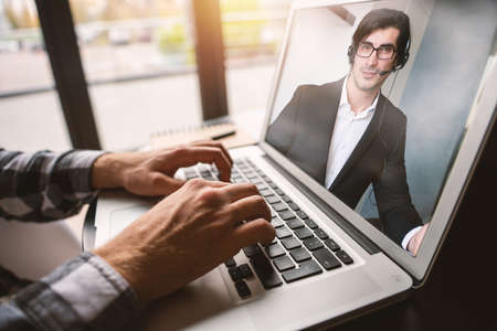 Businessman is working in remote with a videocall due to quarantine. Concept of smart working