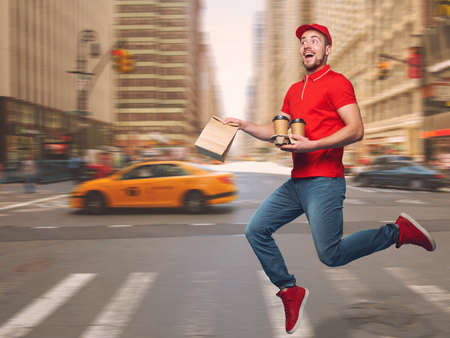 Delivery guy dressed in red runs to deliver the ordered drinks