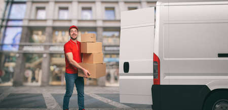 Red courier outside carries parcels with a withe van for deliveries of shipments.