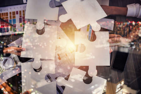 Teamwork of partners. Concept of integration and startup with puzzle pieces Standard-Bild