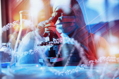 Doctor in the laboratory analyzes samples under a microscope. Pharmaceutical treatment concept.