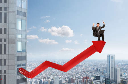 Businessman over a growing red statistic arrow. Concept of success