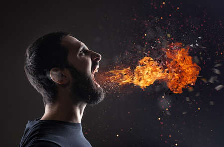Stressed man screams with fire and smoke that exit from the mouth