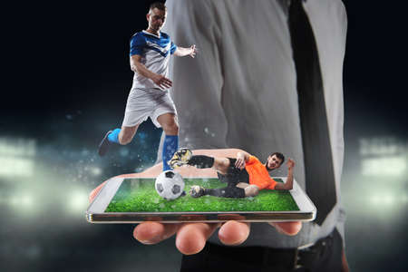 Real soccer players that are displayed on a cellphone during a match