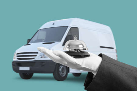 Waiter with bell in hand van. Concept of first class service in your transport.
