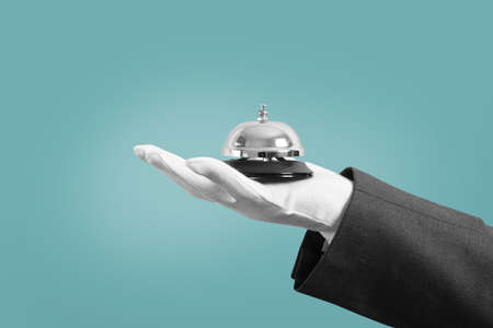Waiter with bell in hand. Concept of first class service in your business.