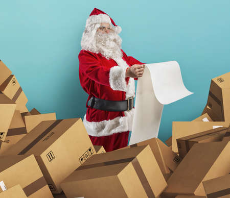 Santa Claus is full of presents request and boxes to delivery 免版税图像