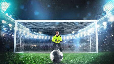 Soccer goalie ready to save a penalty kick at the stadium Фото со стока