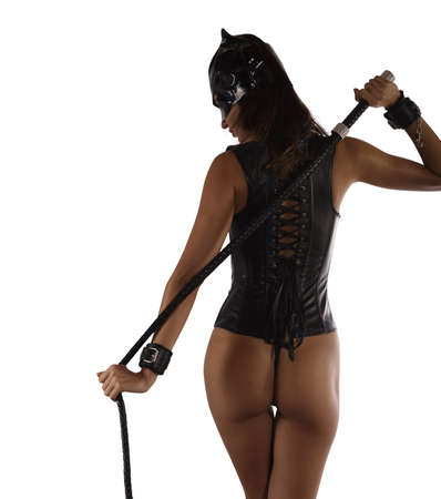 Sexy woman in lingerie bdsm style with a whip in hand. Isolated on white background
