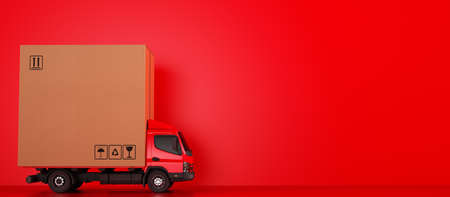 Big cardboard box package on a red truck ready to be delivered Standard-Bild