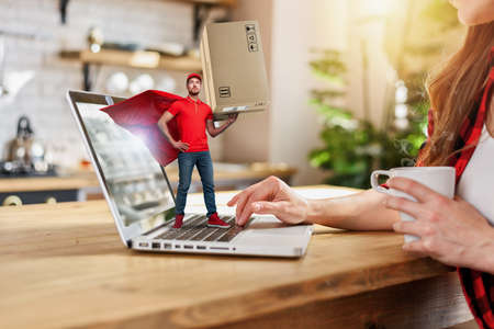Woman does shopping through e-commerce online shop. Concept of super fast delivery Standard-Bild - 161951258