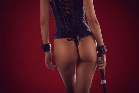 Sexy woman in lingerie bdsm style with a whip in hand Standard-Bild - 161951937