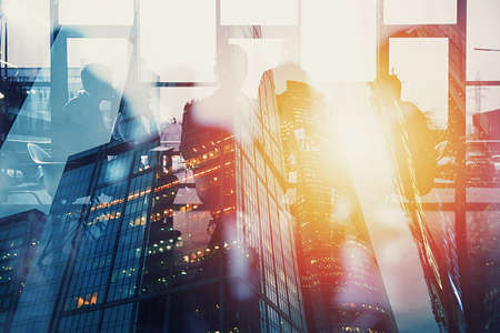 Background concept with business people silhouette in a meeting. Double exposure and light effects