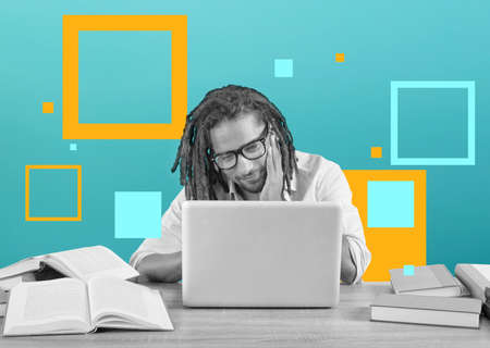 Student studies with his laptop with a desk full of books. Concept on online exam Standard-Bild - 162391826