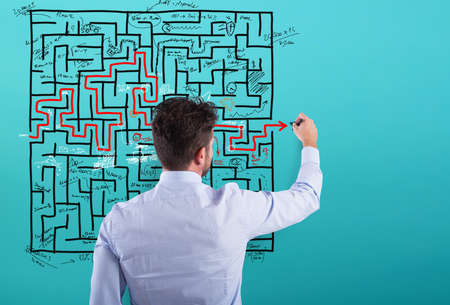 Businessman solve a complex maze with a lot of difficulties Stock Photo