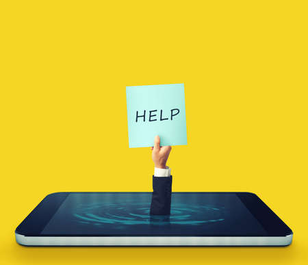 Man is sinking into a smartphone display and asking for help with a sign