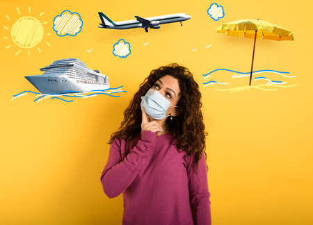 Woman want to travel but is worried about the pandemic. yellow background