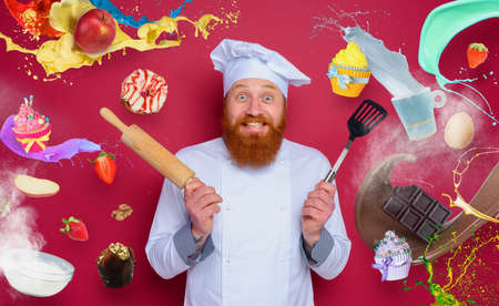 Man chef is happy to cook a new creative recipe. burgundy color background