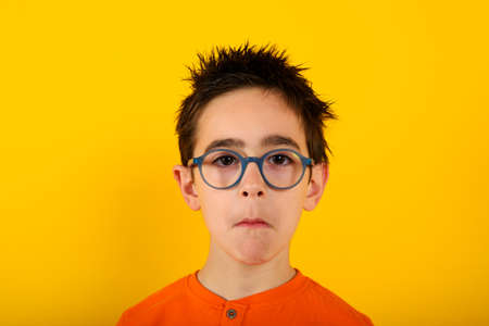 Child is not sure about something and has some questions. yellow background