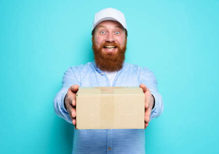 Courier is happy to deliver a carton box. Emotional expression. Cyan background