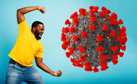 Man attacks with a punch the coronavirus. Blue background