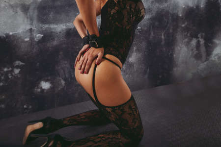 Sexy woman in lingerie and bdsm style with grunge backround