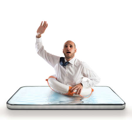 Businessman with lifebelt risks drowning on the screen of a smartphone
