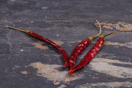 red peppers: Dried red peppers on gray slate Stock Photo