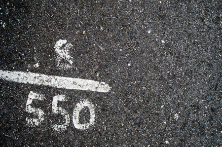 numbering: White numbering on asphalt