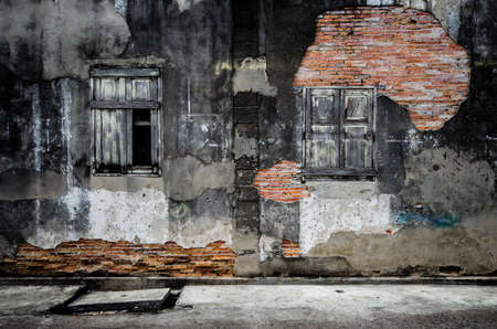 Broken windows on old home wall in Songkhla,Thailand photo
