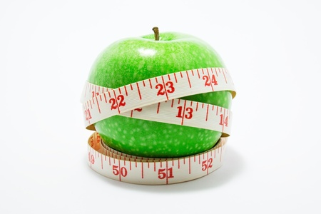 Measurement tape wrapped around green apple Stock Photo